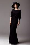 Full length shot of a woman in long black dress and hat Royalty Free Stock Photos