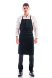 Full length shot of young chef or waiter posing Royalty Free Stock Photos