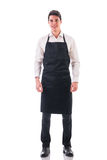 Full length shot of young chef or waiter posing Royalty Free Stock Photography