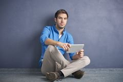 Young man with digital tablet Stock Photography