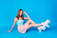Full length side profile body size photo beautiful sitting floor she her lady hands arms lean knee retro rollers fit. Ideal body shape wear casual street summer stock photo