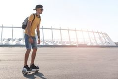 Outgoing boy riding on digital device Stock Image