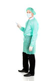 Full length side view male doctor with a scalpel Stock Images