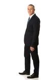 Full length side view man with hand in pocket royalty free stock images