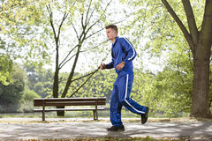 Full length side view of man jogging on path in park Royalty Free Stock Photography