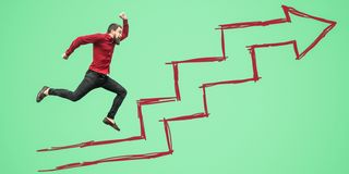 Full length side view portrait of happy bearded businessman un red shirt jumping or flying on green background drawed growth steps. Arrow. success, motivation royalty free stock photo