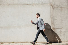 Full length side view portrait of a man in jacket Royalty Free Stock Photography