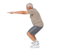Full length side view of a senior man stretching hands Royalty Free Stock Image