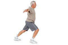 Full length side view of a senior man stretching hands Royalty Free Stock Photo