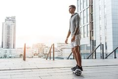 Serene teenager going on hoverboard Royalty Free Stock Photo