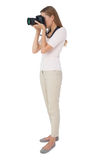 Full length side view of a woman with camera. Over white background stock photos