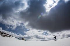 Full length of skier skiing on fresh powder  snow Royalty Free Stock Image