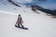 Full length of skier skiing on fresh powder  snow Stock Photo