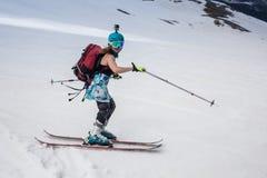Full length of skier skiing on fresh powder  snow Stock Image