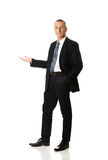 Full length smiling businessman holding copyspace Royalty Free Stock Image