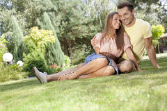 Full length of smiling young couple spending time together in park Royalty Free Stock Photo