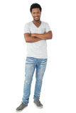 Full length of a smiling young man with arms crossed Royalty Free Stock Photo