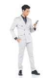 Full Length Snap Figure, Business Man Stand in Gray Suit pants a Stock Photo