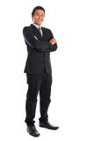 Full Length Southeast Asian businessman standing Royalty Free Stock Photo