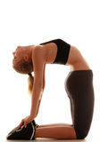 Full length sporty woman doing stretching exercise camel isolated Stock Photography