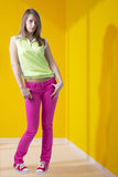 Fashionable Teen Girl Near Yellow Wall Stock Photos