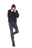 Full length of a stressed handsome young man Royalty Free Stock Photo