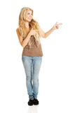 Full length student woman pointing to the right Stock Photo