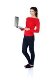 Full length student woman showing her laptop.  royalty free stock photography