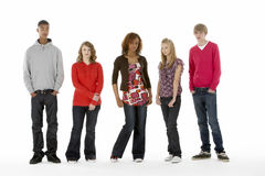 Full Length Studio Portrait Of Five Teenage Friend Stock Photo