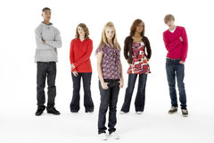 Full Length Studio Portrait Of Five Teenage Friend. S looking at camera royalty free stock photography