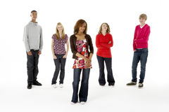 Full Length Studio Portrait Of Five Teenage Friend. S smiling at camera stock image