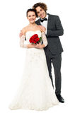 Full length studio shot of adorable couple Royalty Free Stock Photography