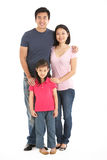 Full Length Studio Shot Of Chinese Family. Smiling royalty free stock images