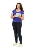 Full Length Studio Shot Of Teenage Girl Using Digital Tablet stock photos