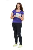Full Length Studio Shot Of Teenage Girl Using Digital Tablet Stock Photos