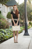 Full length of a stylish woman holding a vanity case Royalty Free Stock Images