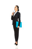 Full length thoughtful businesswoman holding a pen Stock Image