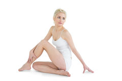 Full length of a thoughtful toned woman Royalty Free Stock Images