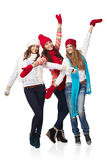 Full length three happy winter girls Royalty Free Stock Image