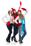 Full length three happy winter girls Stock Images
