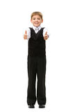 Full length of thumbing up little businessman Stock Photo