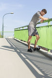 Full length of tired young man leaning on railing after jogging Stock Photo