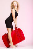 Full length traveler woman with old red bag Stock Photography