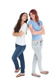 Full length of two female friends with arms crossed Royalty Free Stock Photos