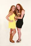 Full length of two girls holding puppy Stock Photos