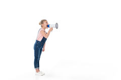 Full length view of adorable little girl screaming in megaphone. Isolated on white Stock Image