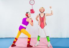 Full length view of beautiful senior female wrestlers in sportswear. And head protection stock photography