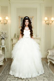 Full length view on beautiful woman posing in a wedding dress. Wedding makeup and hairstyle with diamond crown, fashion bride model jewelry and beauty female royalty free stock images