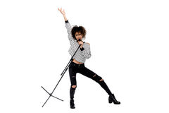 Full length view of beautiful young woman with microphone singing and gesturing isolated on white. Heavy metal singer concept Stock Photography