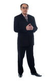 Full length view of elder businessman posing Stock Photos